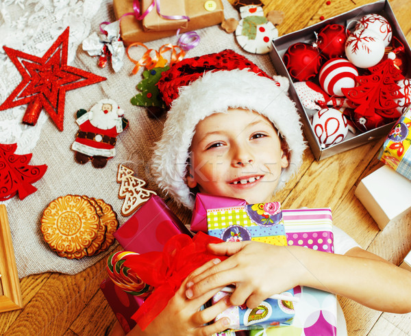 little cute boy with Christmas gifts at home. close up emotional Stock photo © iordani