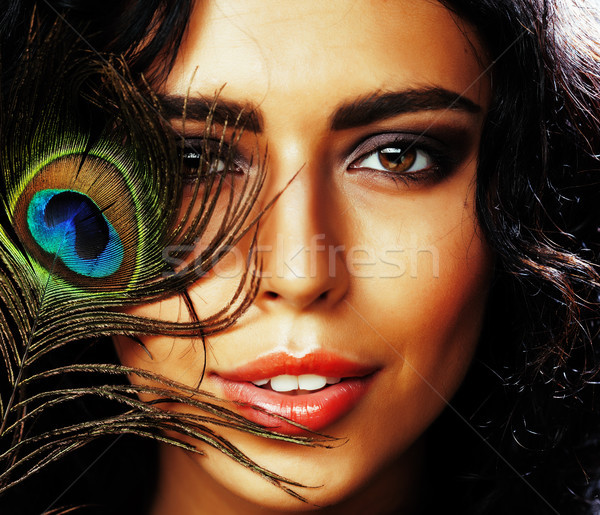 young sensitive brunette woman with peacock feather eyes close up on green smiling, lifestyle people Stock photo © iordani