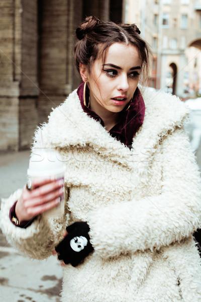young pretty stylish teenage girl outside on city street fancy f Stock photo © iordani