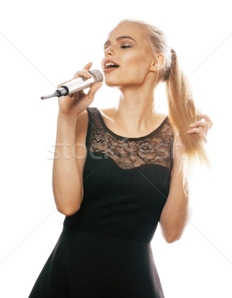 молодые довольно женщину пения микрофона Сток-фото © iordani