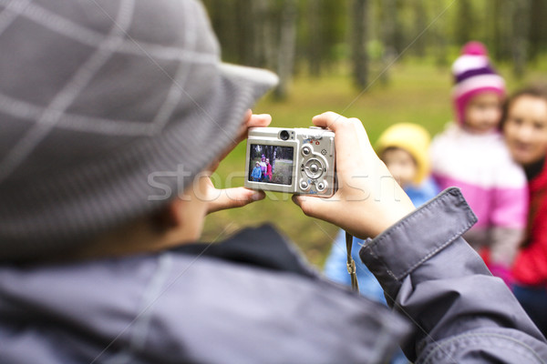 little offspring shooting his family in park outside, lifestyle people concept Stock photo © iordani