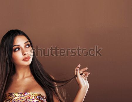 cute happy young indian woman in studio close up smiling, fashion mulatto Stock photo © iordani