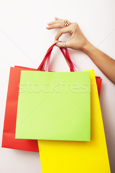 woman hand holding few paper bags on white background isolated, shopping sale concept Stock photo © iordani