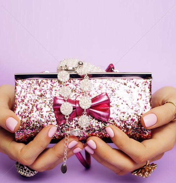 little girl stuff for princess, woman hands holding small cute handbag with jewelry and manicure, lu Stock photo © iordani