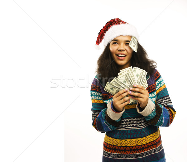 cute young girl in santas red hat with money isolated Stock photo © iordani