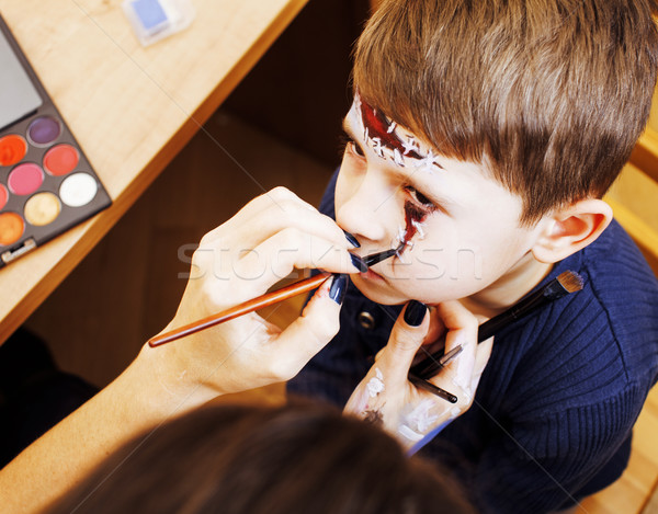 little cute child making facepaint on birthday party, zombie Apo Stock photo © iordani