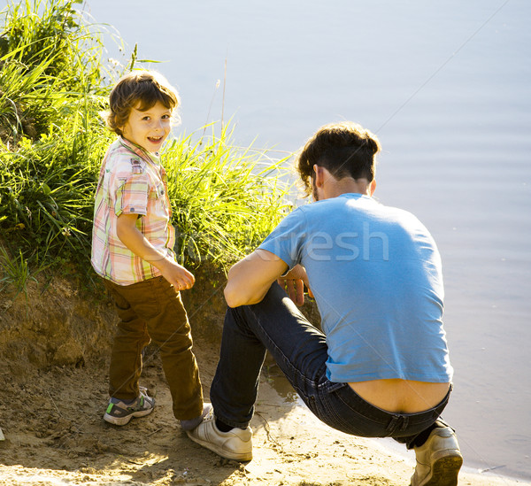 Stock photo: happy smiling little boy with father having fun on summer vacations, lifestyle people concept