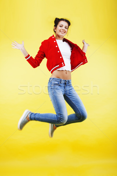 young pretty brunette girl jumping isolated on yellow background, lifestyle flying people concept cl Stock photo © iordani
