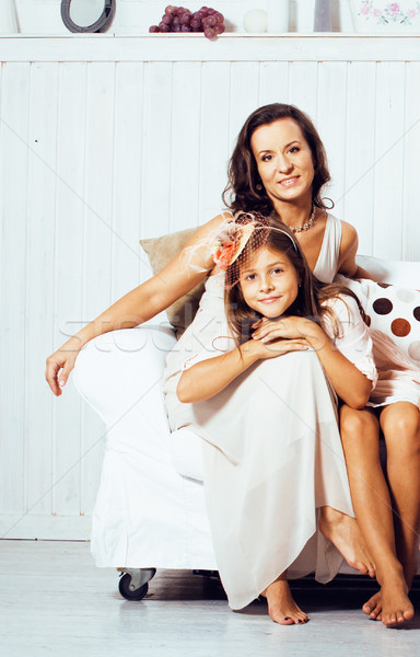 Portrait of smiling young mother and daughter at home, happy fam Stock photo © iordani