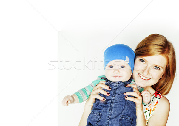 young beauty mother with cute baby, red head happy modern family Stock photo © iordani