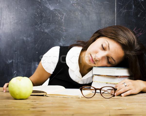 portrait of happy cute real teen student in classroom at blackboard fall asleep Stock photo © iordani
