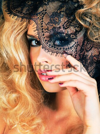 young blond woman dressed like ancient greek godess, gold jewelry close up isolated Stock photo © iordani