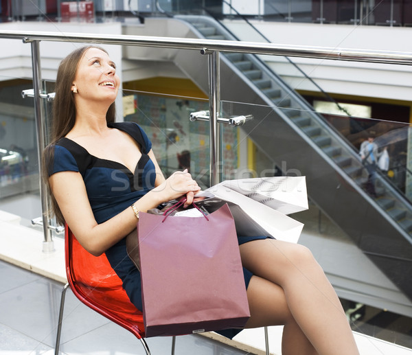 young pretty sweet woman with lot of bags in shopping mall happy smiling, lifestyle people concept Stock photo © iordani