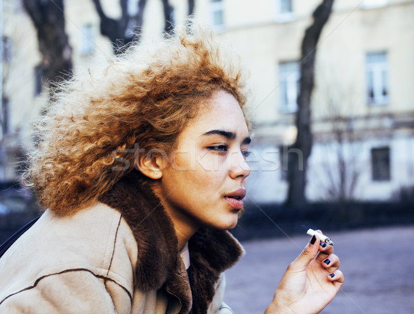 young pretty girl teenage outside smoking cigarette close up, looking like real junky, social issues Stock photo © iordani