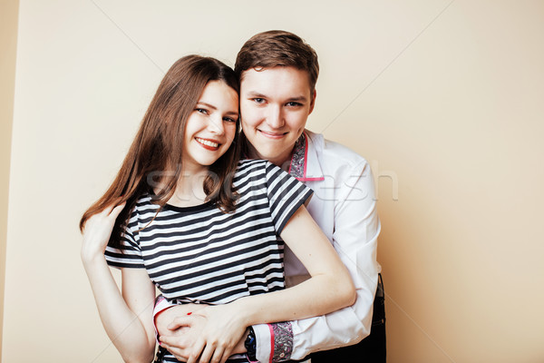 couple of happy smiling teenagers students, warm colors having a Stock photo © iordani