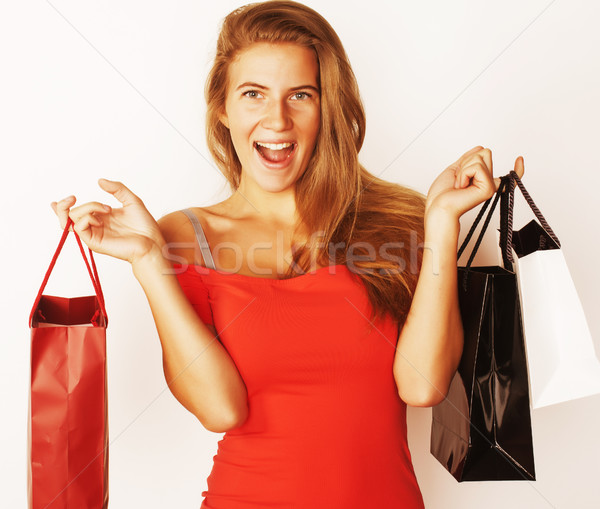 young pretty blond woman with bags on winter sale in red dress i Stock photo © iordani