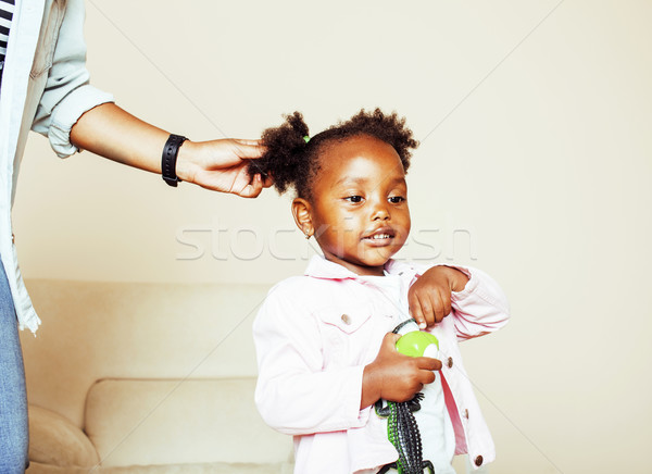 modern young happy african-american family: mother combing daughters hair at home, lifestyle people  Stock photo © iordani