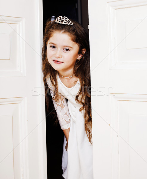 little cute girl at home, opening door well-dressed in white dress and tiara, adorable milk fairy te Stock photo © iordani