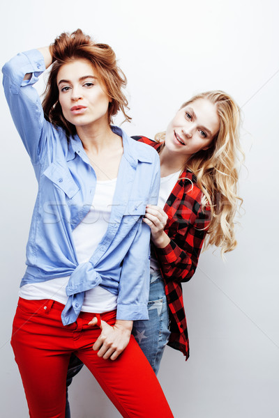 two pretty blond woman having fun together on white background, mature mother and young teenage daug Stock photo © iordani