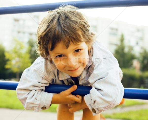 Küçük sevimli erkek oynama oyun alanı asılı Stok fotoğraf © iordani