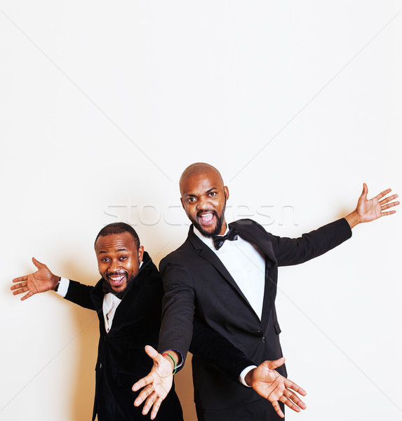 two afro-american businessmen in black suits emotional posing, gesturing, smiling. wearing bow-ties, Stock photo © iordani
