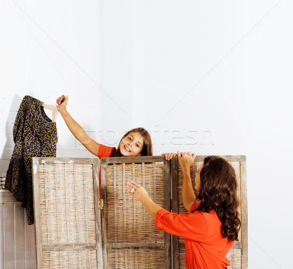 happy mother with daughter trying on dresses at home Stock photo © iordani