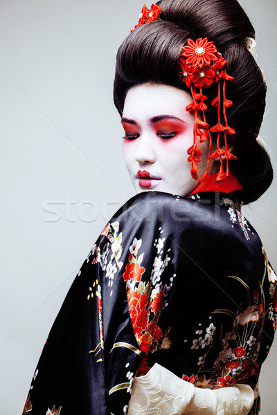 Giovani bella geisha nero kimono sakura Foto d'archivio © iordani