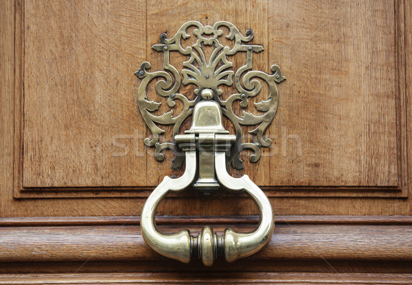 Antique knocker with pattern on wooden brown door, close up macro stuff concept Stock photo © iordani