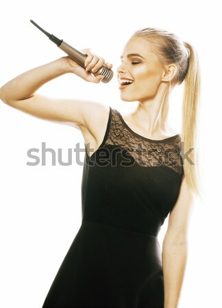 young pretty blond woman singing in microphone isolated close up Stock photo © iordani