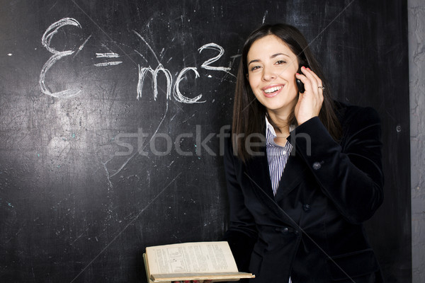 portrait of happy cute student in classroom at blackboard back t Stock photo © iordani