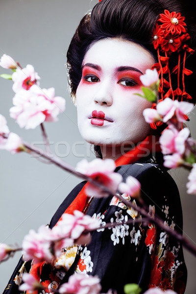 Fiatal csinos gésa fekete kimonó sakura Stock fotó © iordani