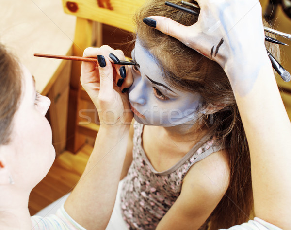 little cute child making facepaint on birthday party, zombie Apocalypse facepainting, halloween prep Stock photo © iordani