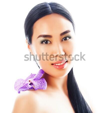 Giovani bella asian donna fiore orchidea Foto d'archivio © iordani