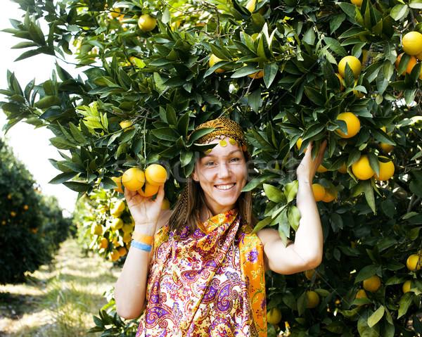 Güzel İslamiyet kadın turuncu gülen Stok fotoğraf © iordani