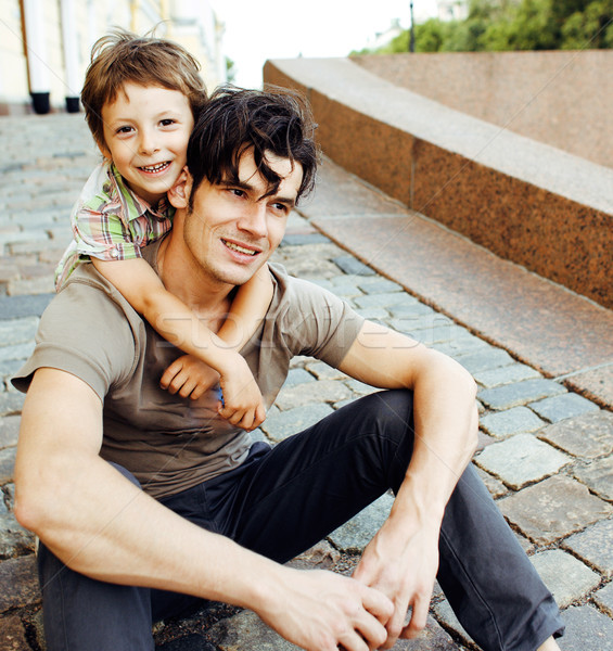 Young father hipster and his little son outside. Talking, teaching, hugging, having fun happy time.  Stock photo © iordani