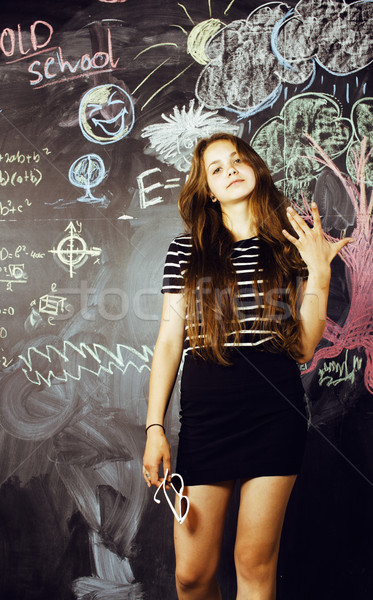 back to school after summer vacations, cute teen real brunette girl in classroom at blackboard, life Stock photo © iordani