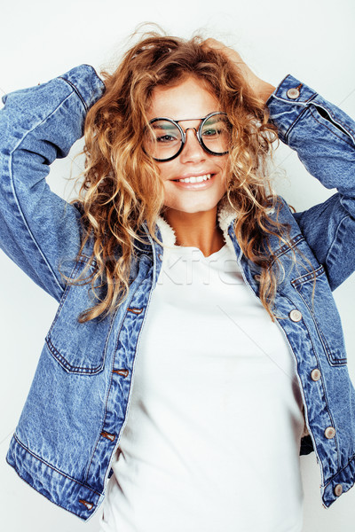 f93185e4b7 pretty young teenage girl blond curly hipster fashion glasses emotional  posing happy smiling on whit Stock