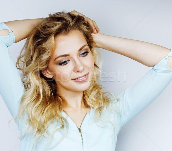 young pretty blond woman smiling on white background close up ma Stock photo © iordani