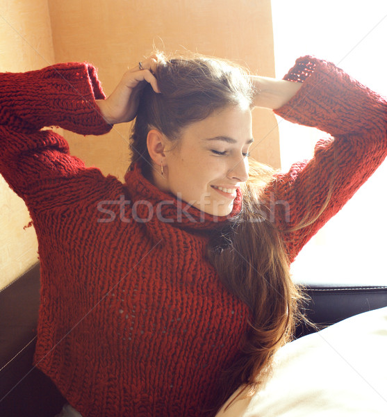 young pretty real woman in red sweater and scarf all over her fa Stock photo © iordani
