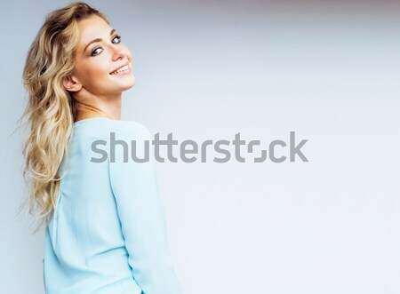 young pretty blond woman smiling on white background close up makeup blue dress Stock photo © iordani