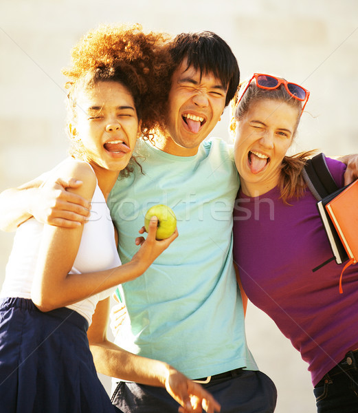 cute group of teenages at the building of university with books  Stock photo © iordani