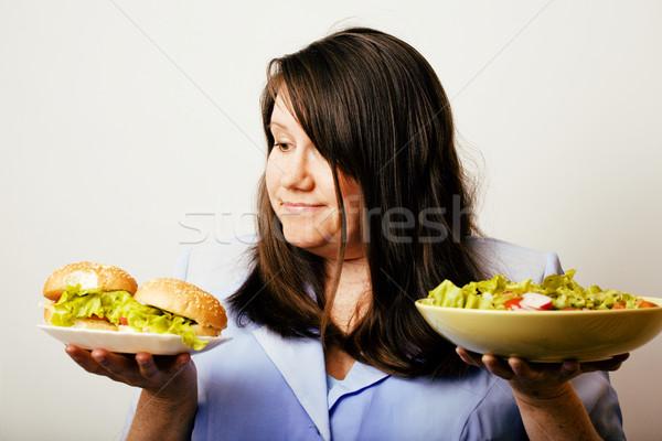 Gordura branco mulher escolha hambúrguer salada Foto stock © iordani