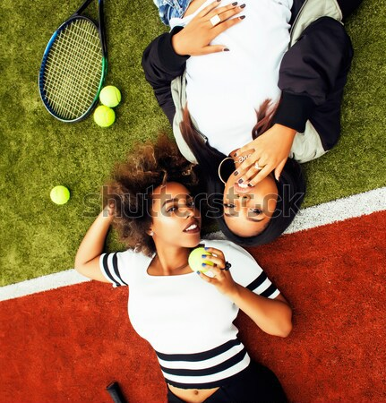 young pretty girlfriends hanging on tennis court, fashion stylish dressed swag, best friends happy s Stock photo © iordani