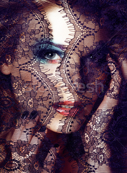 Portrait of beauty blond young woman through black lace close up Stock photo © iordani