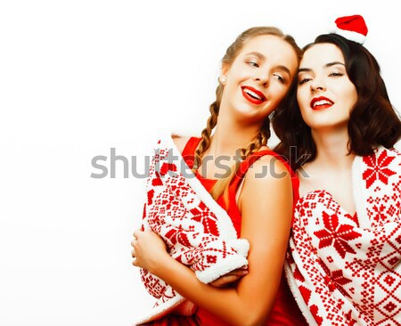 young pretty happy smiling blond and brunette woman girlfriends on christmas in santas red hat and h Stock photo © iordani