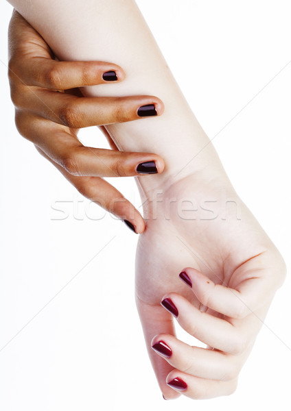 two different nathion manicured hands on white isolated, african Stock photo © iordani