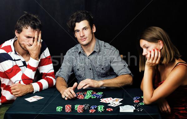 Jóvenes jugando póquer torneo amigos fiesta Foto stock © iordani