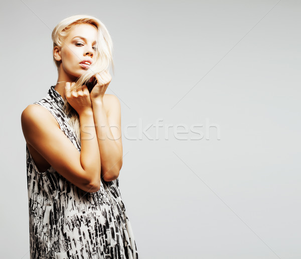 young pretty woman with blond hair on white background, sensual  Stock photo © iordani