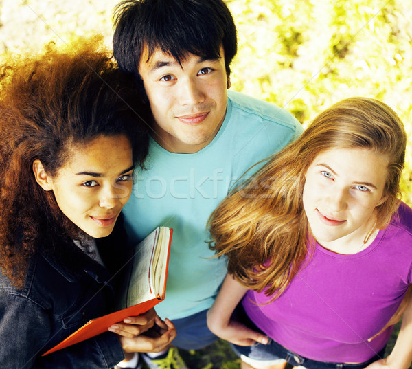 cute group of teenages at the building of university with books huggings, diversity nations Stock photo © iordani