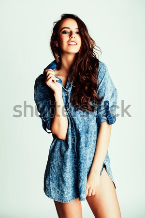 young pretty woman fooling around on blue background close up smiling Stock photo © iordani